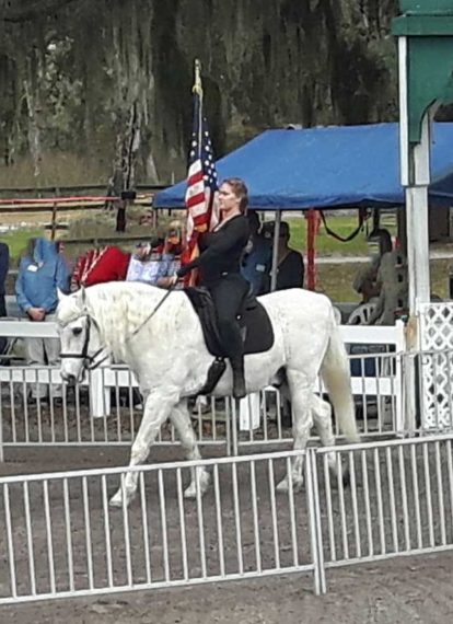 Trooping of the color preceding singing of the national anthem at the Lipizzan stables, Myakka Fl.